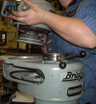 7. On the top of the head, remove the two Socket Head Cap Screws from the top of the Spindle Pulley Bearing Sleeve.